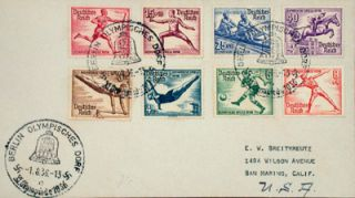 Original envelope with eight illustrated 1936 Olympic post stamps and three Olympic Village...
