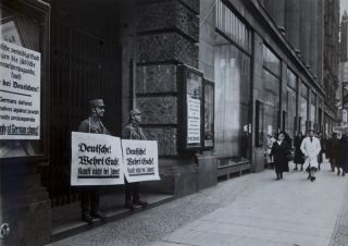 9 original photographs documenting the 1933 boycott of Jewish businesses in Berlin. 9 original...