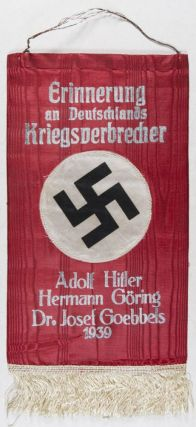 Erinnerung an Deutschlands Kriegsverbrecher: Adolf Hitler, Hermann Göring, Dr. Josef Goebbels, 1939 (In memory of Germany's war criminals) [ANTI-NAZI DOCUMENT]. n/a.