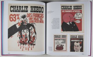 "Charlie Hebdo: Les Unes, 1969-1981 [SIGNED BY CABU] [WITH] Two copies in two different states of Charlie Hebdo's famous relaunch issue ""Tout est Pardonné"" (Everything is Forgiven) [WITH] the special Charlie Hebdo issues of French satirical weekly ""Le Canard Enchainé,"" and France's Communist daily newspaper ""L'Humanité"" (Complete)"