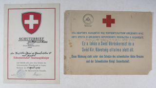 2 Signs for Safe Houses in Budapest 1944: Schutzbrief Geschäft und Haus der Konfektio Ipari [WITH] A Sign for a Swedish Red Cross Safe House in Budapest. n/a.